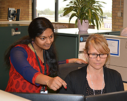 Two women collaborating at work
