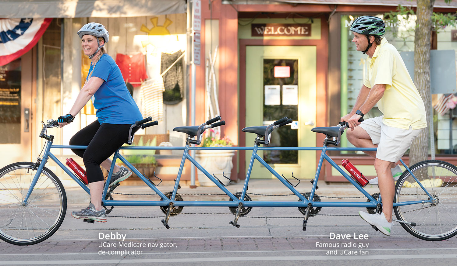 Photo of Debby, UCare Medicare navigator, and Dave Lee, famous radio guy, on bike