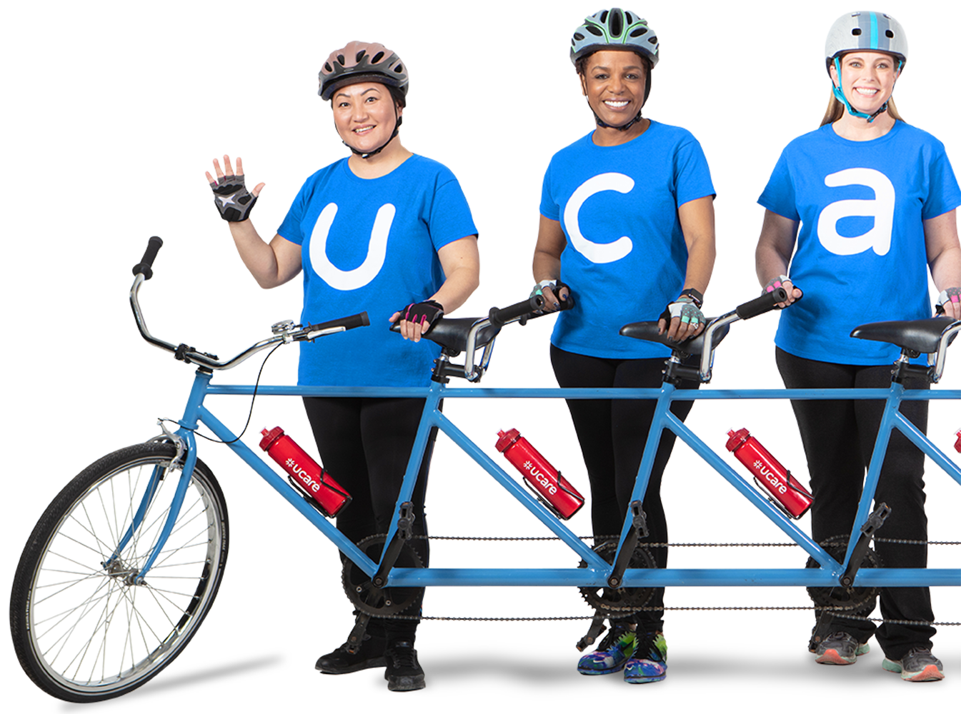 people on the blue UCare tandem bike