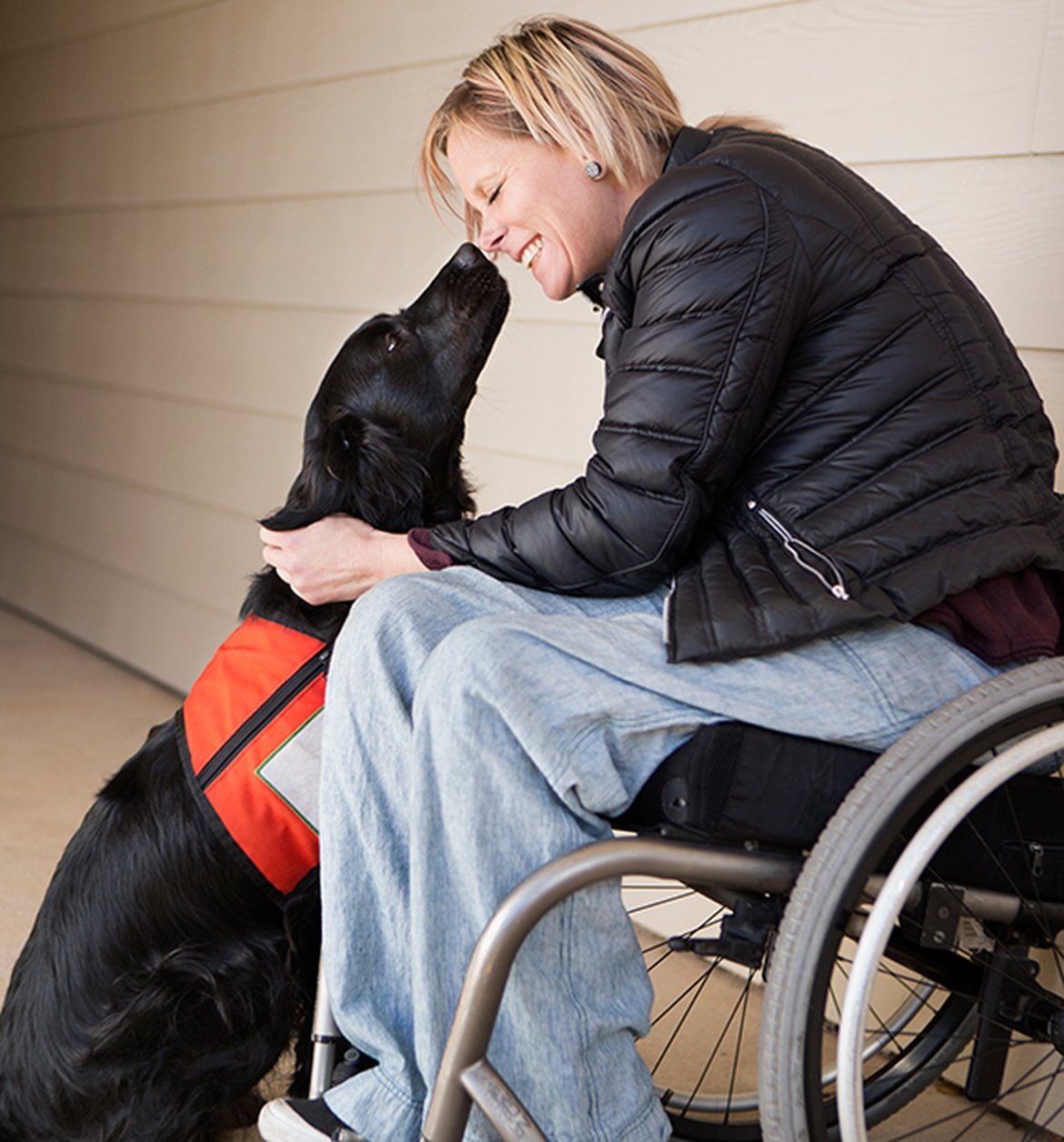 Woman in a wheelchair with her service dog